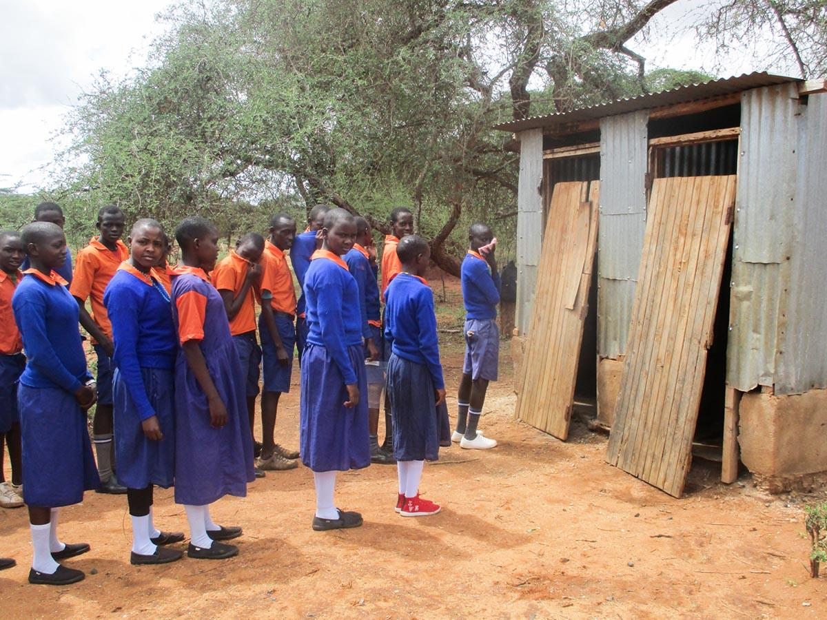 191125 Students in East Africa line up to use outdoor toilets